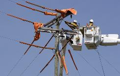 Duke Energy linesmen work on power lines in Charlotte