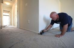 Russell Scitern installs carpet in a KB Home under construction in Live Oak, Calif.