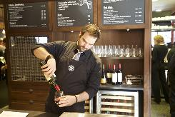 Barista supervisor Michael Rotman Koenen pours wine at a Starbucks in Seattle that could be the Starbucks of the future.