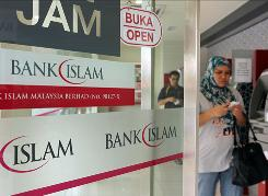 A customer exits a branch of BIMB Holdings, formerly known as Bank Islam Malaysia, in Kuala Lumpur, Malaysia, on Sept. 25. From 2007 to 2009, Islamic banks' assets grew an average of twice as fast as conventional banks' assets in major Muslim markets.