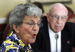 Stella Wehrly, left, speaks during an interview as her husband Hank Wehrly looks on, at the St. Andrews Estates North retirement community, Monday, Oct. 11, 2010 in Boca Raton, Fla. Seniors prepared to cut back as the news spread that they will have to wait until at least 2012 to see their Social Security checks increase.