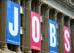A jobs sign is seen on the front of the Chamber of Commerce building in Washington.