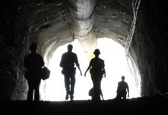 Workers at the entrance of the Sunrise Dam gold mine in Australia. There are many ways to invest in gold without owning the metal itself.