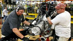 Power source: Ford Motor employees Jim Van, left, and Brian Ahola place an engine into the chassis of a 2009 Ford F-150 pickup at the Dearborn Truck Plant in Dearborn, Mich., on Oct. 30, 2008.