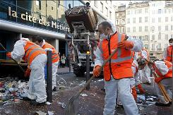 Garbage collectors began tackling Marseille's reeking mounds of trash. Striking garbage collectors in Marseille faced 9,000 tons of garbage that have piled up in the streets in the last two weeks.