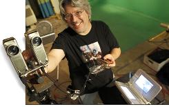 Eric Kurland shows off his 3-D camera shooting rig in his basement workshop in Echo Park, Calif. He just produced a 3-D music video for the rock band OK Go.