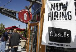 Customers walk into a Chipotle restaurant, Tuesday, Sept. 21, 2010, in Mountain View, Calif. Shares of Chipotle are up more than 141% so far this year.