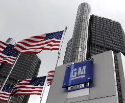 General Motors world headquarters in Detroit. GM plans to pay down $2.1 billion from the amount owed the government.