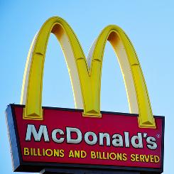 McDonald's reported net income jumped 10% in the third quarter as new drinks and dollar menu boosted sales.