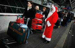 A man dressed as Santa Claus stands with passengers at Heathrow Airport in London in 2006.