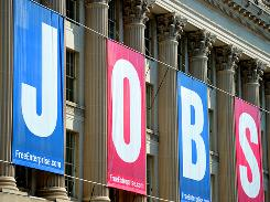 A jobs sign is seen on the front of the U.S. Chamber of Commerce building in Washington, D.C. on September 2, 2010.