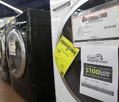 An energy rebate sign is shown on a Maytag washing machine at Western Appliance in Mountain View, Calif.