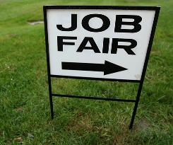 A sign directs people to the job fair at Prince George's Community College, on November 4, 2010, in Largo, Maryland.