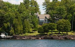 This waterfront Cape-style home on 1.17 acres is on the market for $2.2 million.