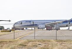Firefighters and airport officials investigate the scene of an incident involving a Boeing 787 jetliner at the Laredo International Airport in November.