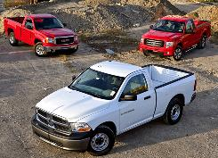 The contenders are: Ram 1500, front, GMC Sierra 1500, left rear, and Ford F-150. The USA TODAY/PickupTrucks.com V-6 Work Truck Shootout compared the three basic pickups in a variety of tests.