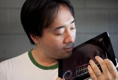 Smule co-founder Ge Wang plays with his latest app for the iPad, Magic Fiddle, which is a virtual violin that you play on the iPad. 