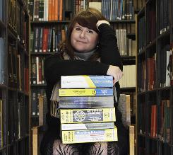 Emily Goodmann sits with a small stack of phone books at the Northwestern University Library in Evanston, Ill,, in this Nov. 9, 2010 photo. Goodmann is a doctoral student who is doing her dissertation on the history of the telephone book.