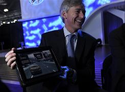 Hyundai Motor America President John Krafcik shows off some of the features of an iPad app with the owners' manual to the company's Equus.
