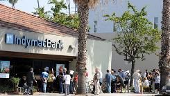Customers line up in front of an IndyMac Bank in Santa Monica, Calif., July 14, 2008. The FDIC in a civil suit is seeking $300 million in damages from four former executives at IndyMac, one of the biggest bank failures in U.S. history.