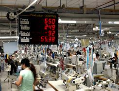 A production control board counts down how much clothing remains to be completed in a shift at TAL Group's Qingxi factory in southern China.