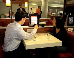 At JFK guests can use free iPads in the waiting area to select meals to be served at their seats.