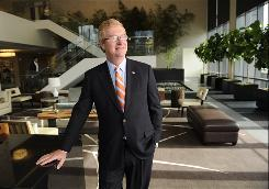 Stephen Holmes, head of Wyndham Worldwide, stands in the lobby of company headquarters in New Jersey.
