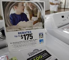 Retailers often use mail-in rebates to entice shoppers. A rebate sign is shown on top of a washing machine at Western Appliance in Mountain View, Calif., in this Sept. 30, 2010 photo.