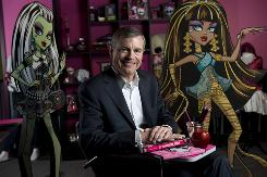 """Mattel CEO Bob Eckert with Monster High's """"Frankie Stein,"""" daughter of Frankenstein, and """"Cleo De Nile,"""" daughter of the Mummy."""