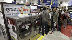 "Shoppers line up in the appliance section of a Best Buy in Tacoma, Wash., in the early hours of Black Friday. ""Appliances are extremely hot,"" says Gregg Throgmartin of hhgregg."