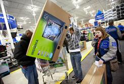 "Shoppers Diman Mande, left, Daniel Herfeldt and Sylvia Herfeldt secure a 42"" flat screen TV at Best Buy on Friday."