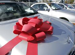 Some dealerships put bows on cars to encourage customers to think of a car as a present.