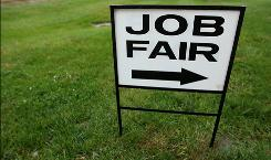 A sign for a November job fair in Largo, Md.