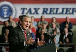 President Bush talks of his efforts to cut taxes at an Indianapolis appearance in 2003.