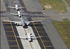 Jets on a taxiway at John F. Kennedy airport.