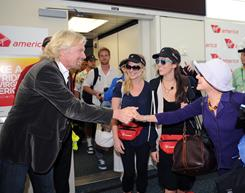 Virgin Group founder Richard Branson talks with passengers to mark Virgin America's new service at Orlando International Airport on Oct. 13. Virgin Atlantic earned praise for its in-flight entertainment.