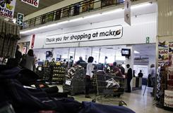 Customers make their way to the tills at Makro megastore in Milnerton on the outskirts of Cape Town. Makro is one of the trading brands of South African giant retail wholesaler Massmart.