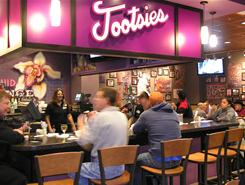 Travelers visit Tootsie's Orchid Lounge at Nashville International Airport.