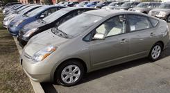 Unsold 2007 Prius gasoline-electric hybrids sit on the lot of a Toyota dealership in Boulder, Colo., in 2007.