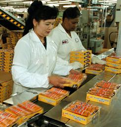 Workers pack crackers at Lance's Charlotte, N.C., plant in this file photo.