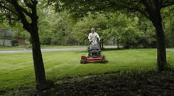 Lucas Rice cuts one of his clients' lawns in May 2009.
