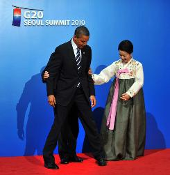 In a light moment at November's G20 meeting, President Obama is positioned for a photo op by South Korean President Lee Myung-Bak as his wife Kim Yoon-Ok looks on.