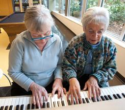 Willoughby Walshe, right, works with student Mary Montgomery during a piano lesson taught by Walshe at the Northgate Community Center in Seattle.