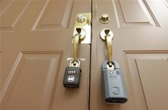 In this Sept. 14, 2010 photograph, dual locks are on the front door of empty house in Homestead, Fla., to prevent unauthorized entry into the foreclosed home.
