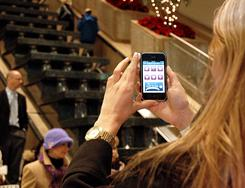 Helpers: A shopper at Water Tower Place in Chicago uses a shopping app.