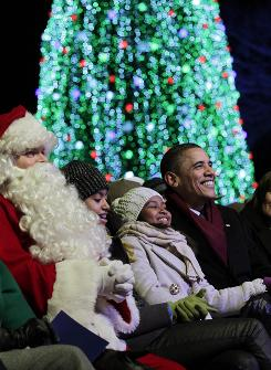 President Obama, with daughters Malia, 12, and Sasha, 9, are joined by Santa Claus at the National Christmas Tree lighting ceremony on Dec. 9.