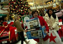 Customers carry boxes of appliances at The Fashion Centre at Pentagon City in Arlington, Va., on Nov. 26.