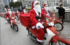 South Korean postmen dressed as Santa Claus on delivery bikes leave post office headquarters Dec. 13 to deliver Christmas gifts in Seoul.
