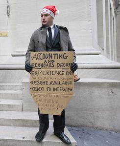 "Jesse Paloger stands on Wall Street as he hopes to find a job. Paloger, who has an accounting and economics degree from UC Santa Barbara, has written on his sign, ""Go-getter from California looking for my shot!"""