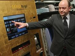 Thomas Geissler demonstrates his Gold To Go dispenser Oct. 21, 2010 in Berlin, Germany.
